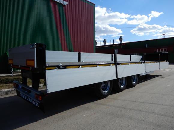 НОВИНКА: 3-осный двускатный бортовой полуприцеп для перевозки контейнеров и различных грузов!